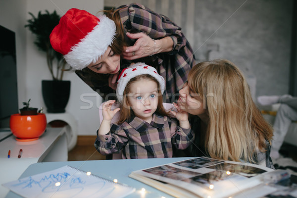 mother, grandmother, the little girl in the room Stock photo © tekso