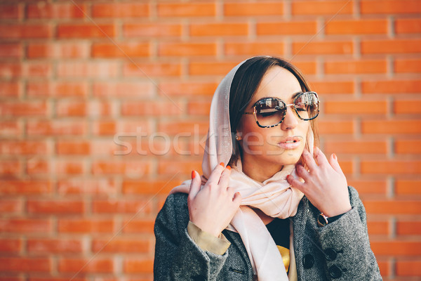 girl posing on a background of red brick wall Stock photo © tekso