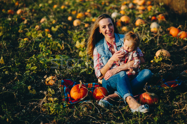mother and daughter on a field with pumpkins Stock photo © tekso