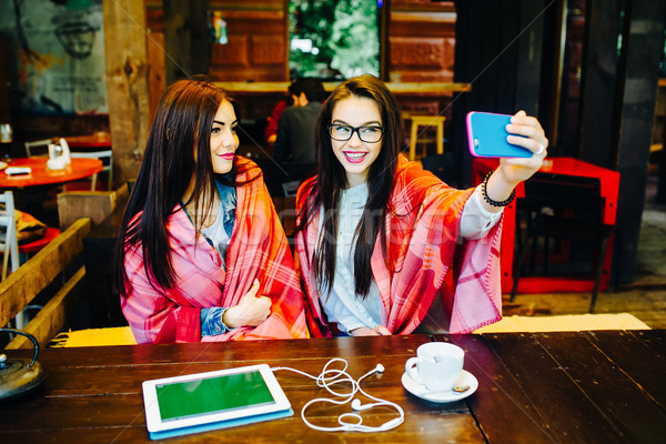 two close friends make selfie in the cafe Stock photo © tekso