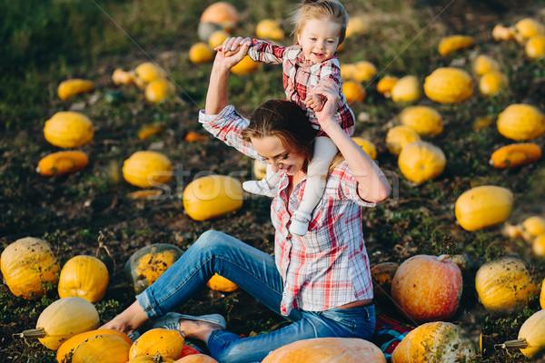 Mãe jogar filha campo abóboras halloween Foto stock © tekso