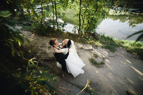 Beautiful wedding couple hugging in the park Stock photo © tekso