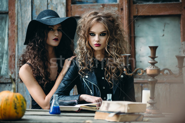 Two vintage witch sitting at the table Stock photo © tekso