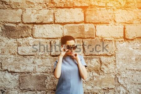 çekici moda kadın mavi elbise güneş gözlüğü Stok fotoğraf © tekso