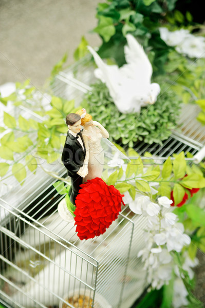 Dove Cage with Wedding Figurines Stock photo © tepic
