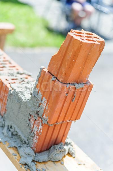 Poor work with bricks Stock photo © tepic