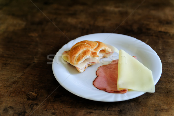 Bitten Bun with ham and cheese Stock photo © tepic