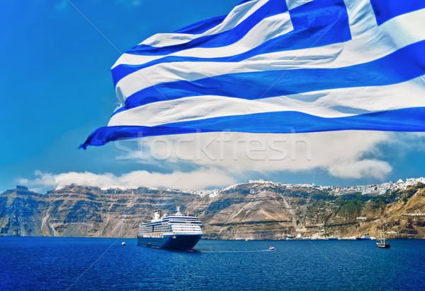 Greek Flag in front of Santorini Stock photo © tepic