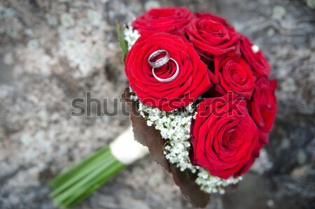 Wedding Rings on Red Roses Stock photo © tepic