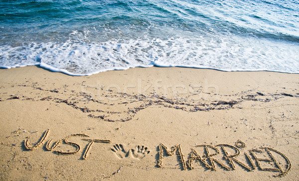 Stock photo: Just Married written in the Sand