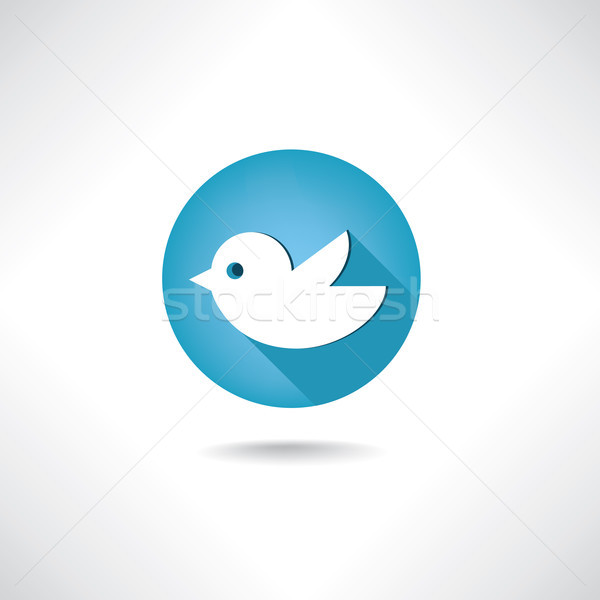 Trendy round blue twitter bird social media sign. Bird icon. Stock photo © Terriana