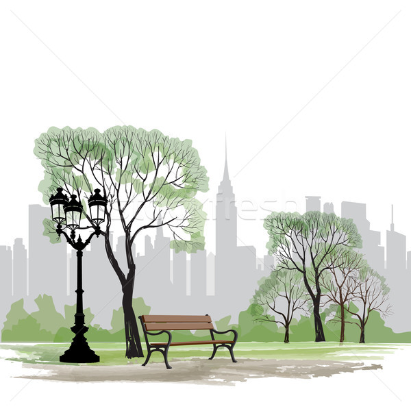 Bench and streetlight in park. City background. Landscape skyline Stock photo © Terriana