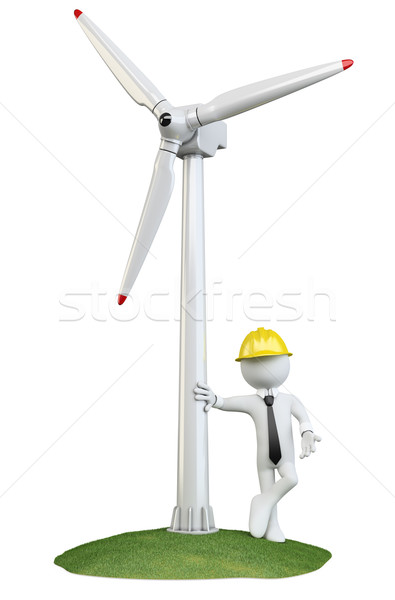Stock photo: Man leaning on a wind turbine
