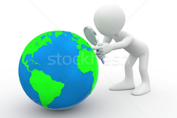 Man with big magnifying glass looking at Earth Stock photo © texelart