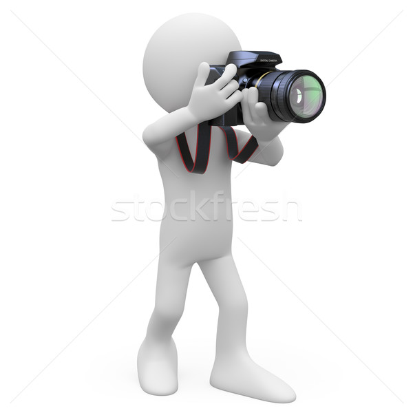Stock photo: Man taking a picture with his SLR camera