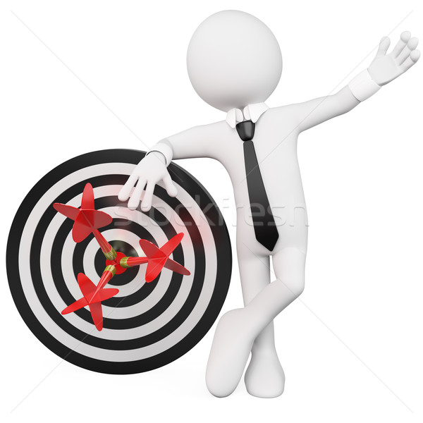 Stock photo: Man leaning on a target with three darts stuck in the bull's eye