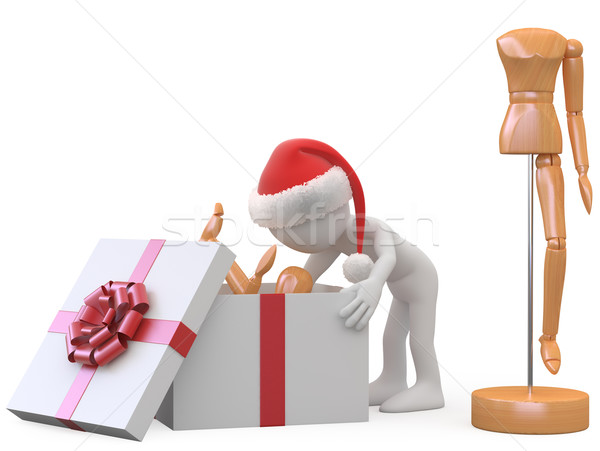Man with Santa hat taking out a wooden doll of a gift box Stock photo © texelart