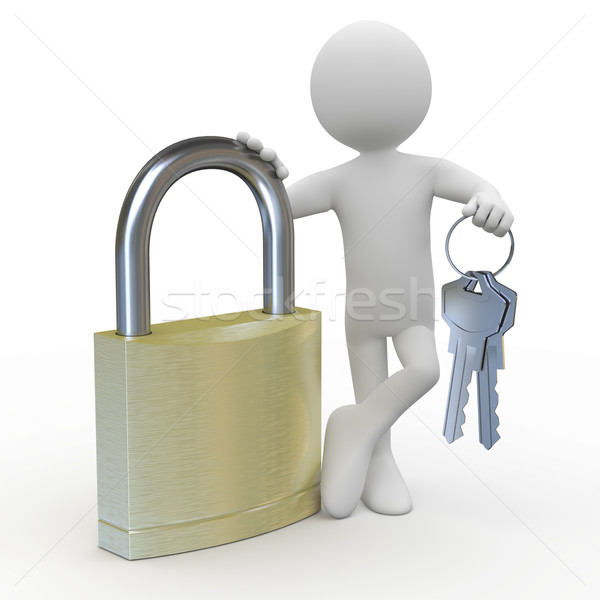Man leaning on a huge padlock with keys in hand Stock photo © texelart
