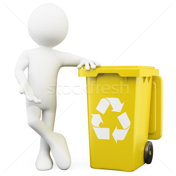 Stock photo: 3D man showing a yellow bin for recycling