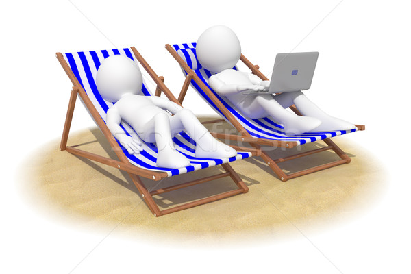 Couple sitting in beach chairs, the man has a laptop on his knees Stock photo © texelart