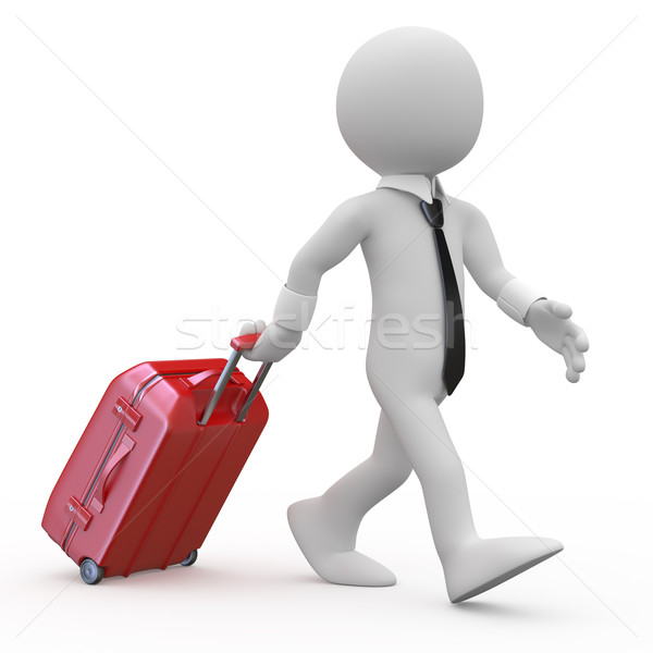 Businessman pulling a red trolley suitcase Stock photo © texelart