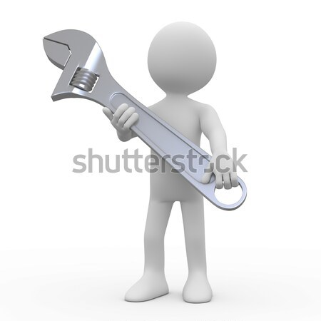 Man with a huge adjustable spanner tightening a nut Stock photo © texelart