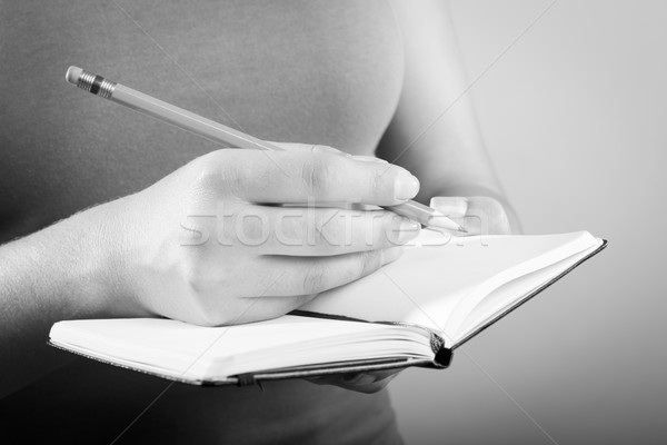 Woman Writing In Notebook Black and White Stock photo © THP