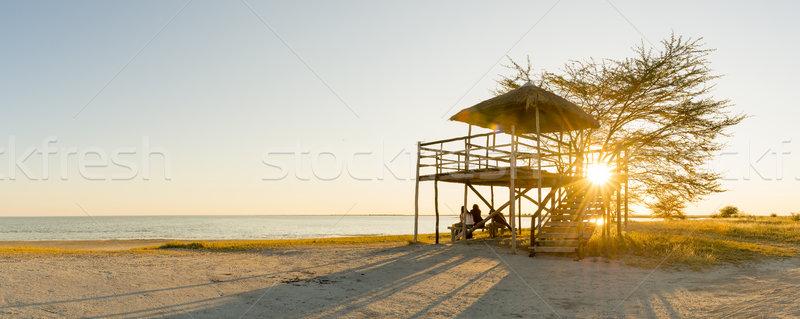 Arkadaşlar gün batımı plaj kulübe grup oturmak rahatlatıcı Stok fotoğraf © THP