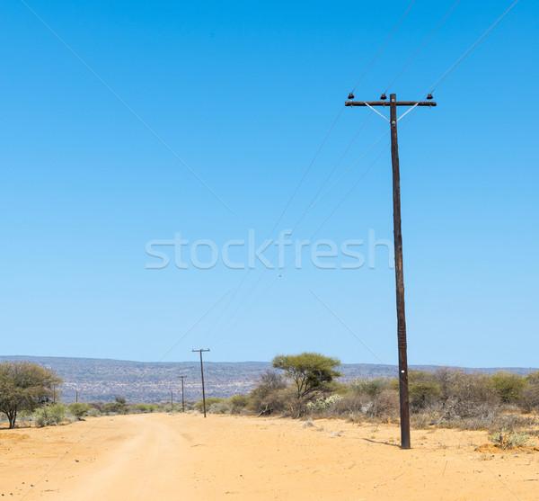 Afrika elektromosság vonalak távvezeték fut földút Stock fotó © THP