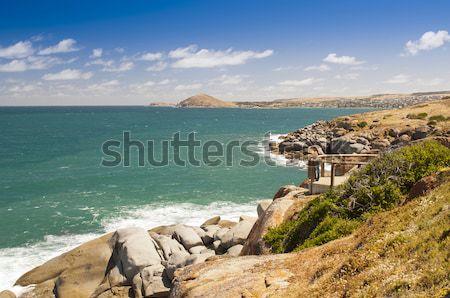 Gránit sziget fiatal női turista perem Stock fotó © THP