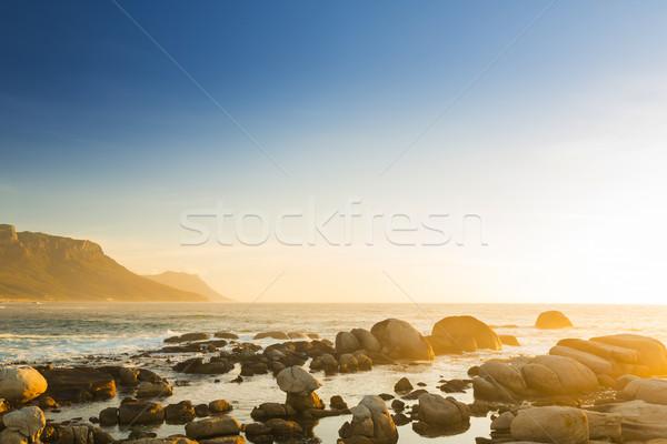Dél-afrikai óceán naplemente kő Dél-Afrika tengerpart Stock fotó © THP