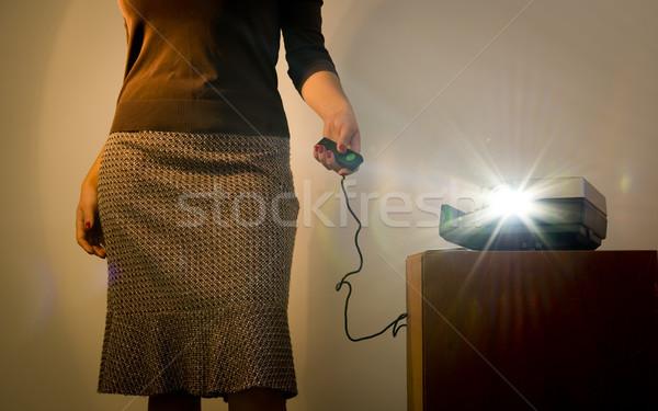 ретро слайдов проектор женщину пультом Сток-фото © THP