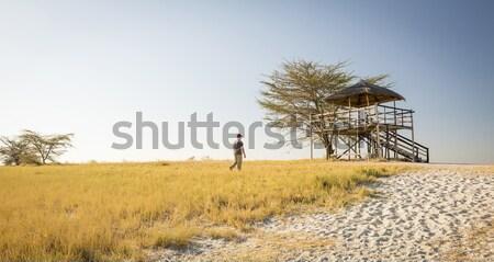Woman in African Hut on Safari Stock photo © THP