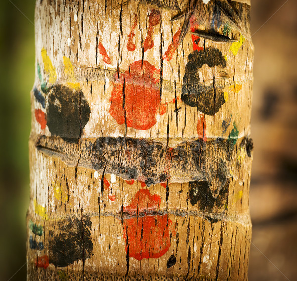 Childrens Handprints On Tree Trunk Stock photo © THP