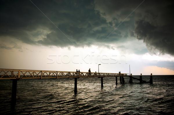Fırtına bulutları dev siyah insanlar balık Stok fotoğraf © THP