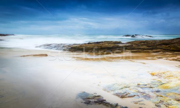 бурный пляж пейзаж волны пород небе Сток-фото © THP