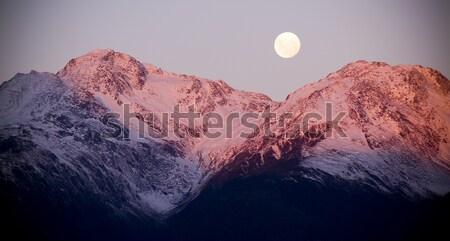 Luna nieve montanas crepúsculo puesta de sol Foto stock © THP