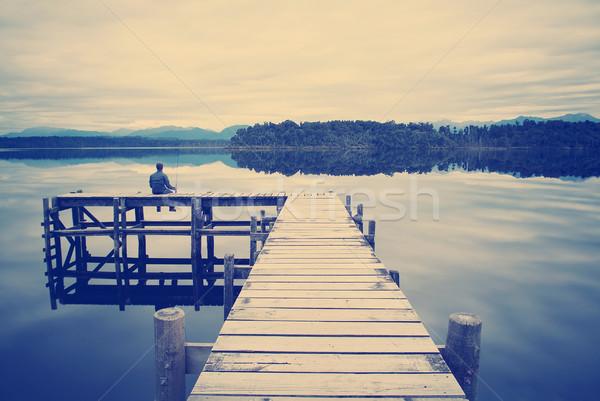 Balıkçı oturma göl balık tutma Retro Stok fotoğraf © THP