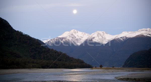 Luna nieve montanas río primer plano Foto stock © THP