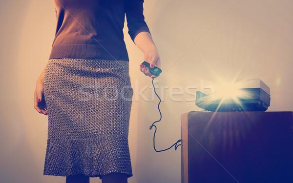 Retro slayt projektör kadın uzaktan kumanda Stok fotoğraf © THP
