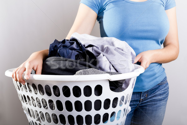 Woman Holding Dirty Laundry Stock photo © THP