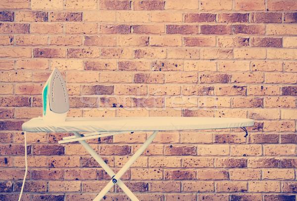 Vasalás tábla retró stílus vasaló téglafal háttér Stock fotó © THP