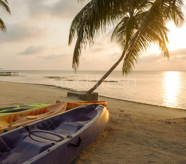 Beach Sunrise With Kayaks Stock photo © THP