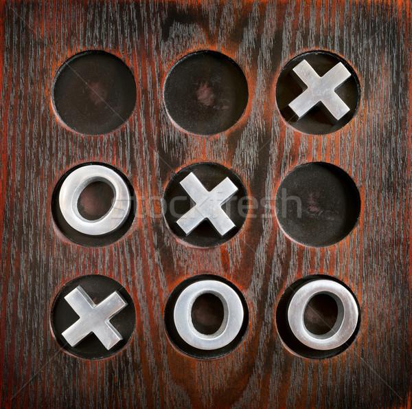 Lábujj játék keresztek fa deszka fém darabok Stock fotó © THP