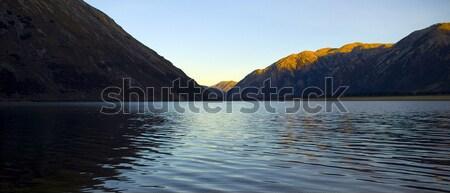 Puesta de sol lago luz viaje rock piedra Foto stock © THP