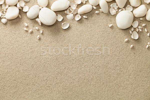 Areia praia conchas pedras cópia espaço topo Foto stock © ThreeArt