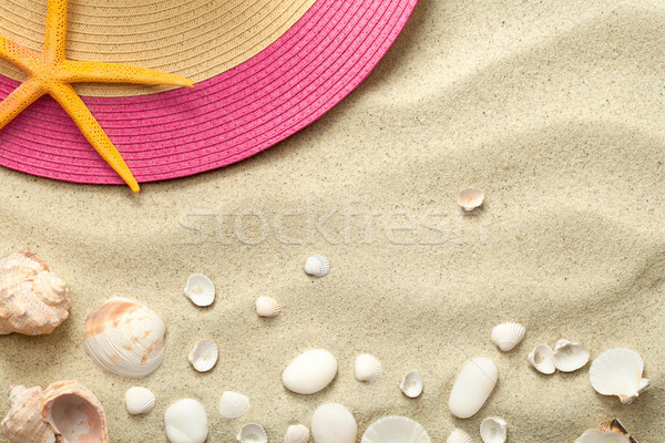 Sand Background with Shells and Summer Hat Stock photo © ThreeArt