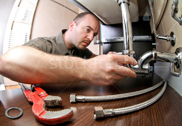 plumber ta work Stock photo © tiero