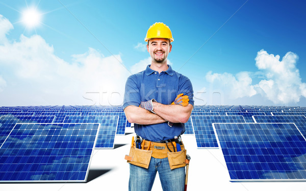 smiling worker and solar power Stock photo © tiero