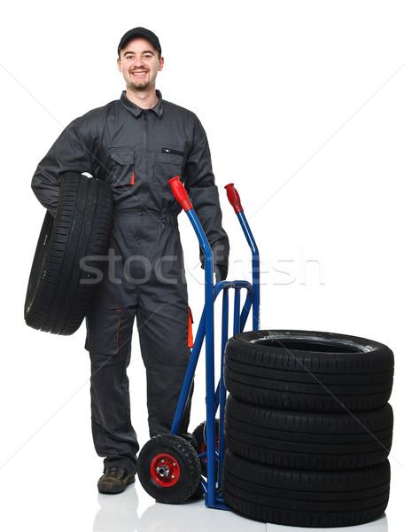 Homme pneus garage costume blanche Photo stock © tiero